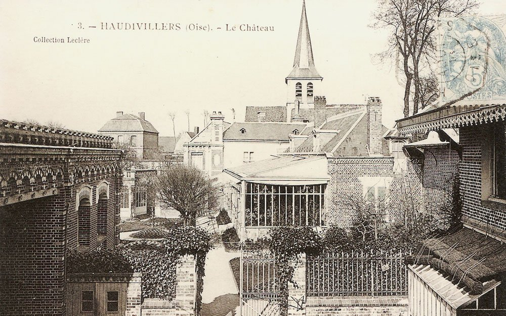 An old postcard showing the house in all its glory with the church in the background