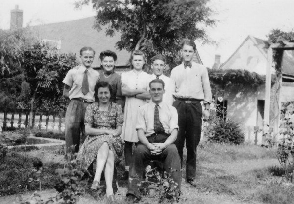 Dad in France in 1951 (seated). Denise Pelletier recalls that the man in the bow tie was also an RAF airman